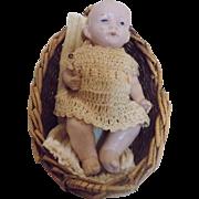 Antique German All Bisque Baby doll w/Basket