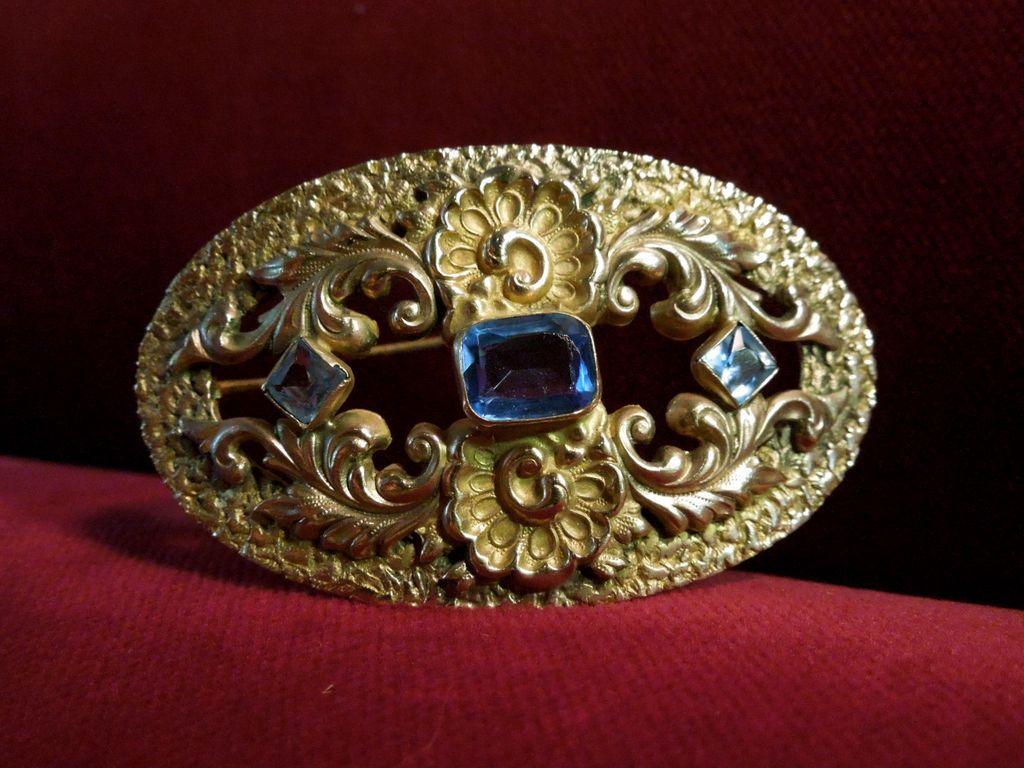 Brass and Light Sapphire Oval Art Nouveau  Brooch
