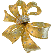 Rhinestone Bow and Sash Gold Tone Pin