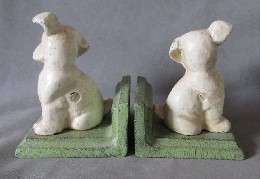 c1920s art deco puppy dog bookends by littco cast iron dogs sold on ruby lane. Black Bedroom Furniture Sets. Home Design Ideas