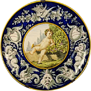 Fine Italian Majolica Faience Charger Plaque with Cherubs, Gargoyle, Dragons