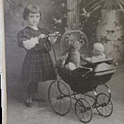 c1910s Girl with Mohair Teddy Bear, Doll & Doll Carriage Photograph