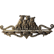 Antique Cast Iron Wall Mount Pipe Rack with Bulldog Motif