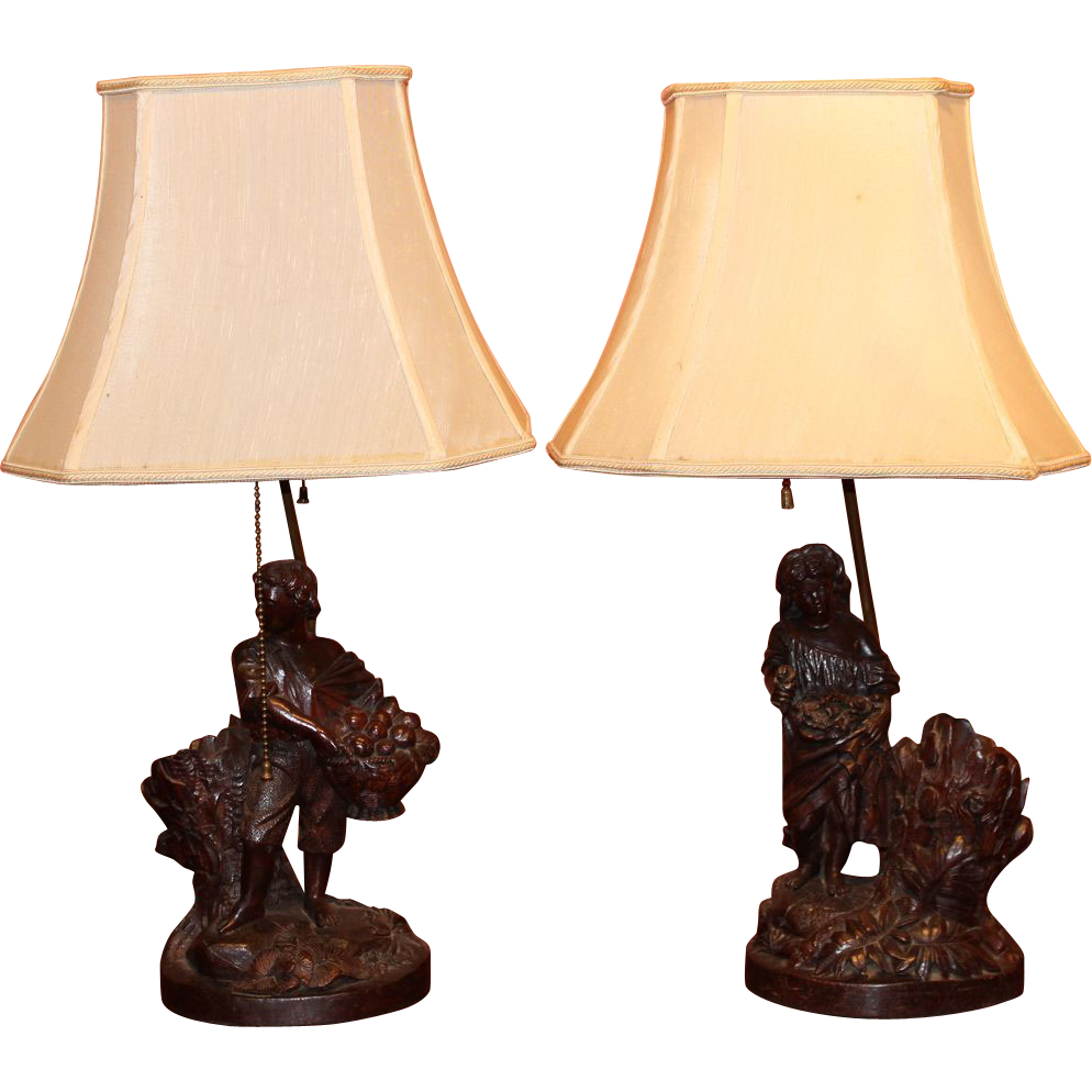 Pair of 19th c German Black Forest Walnut Figural Vase Lamps
