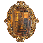 Large 18th c Italian Baroque Oval Gilt Wood Mirror