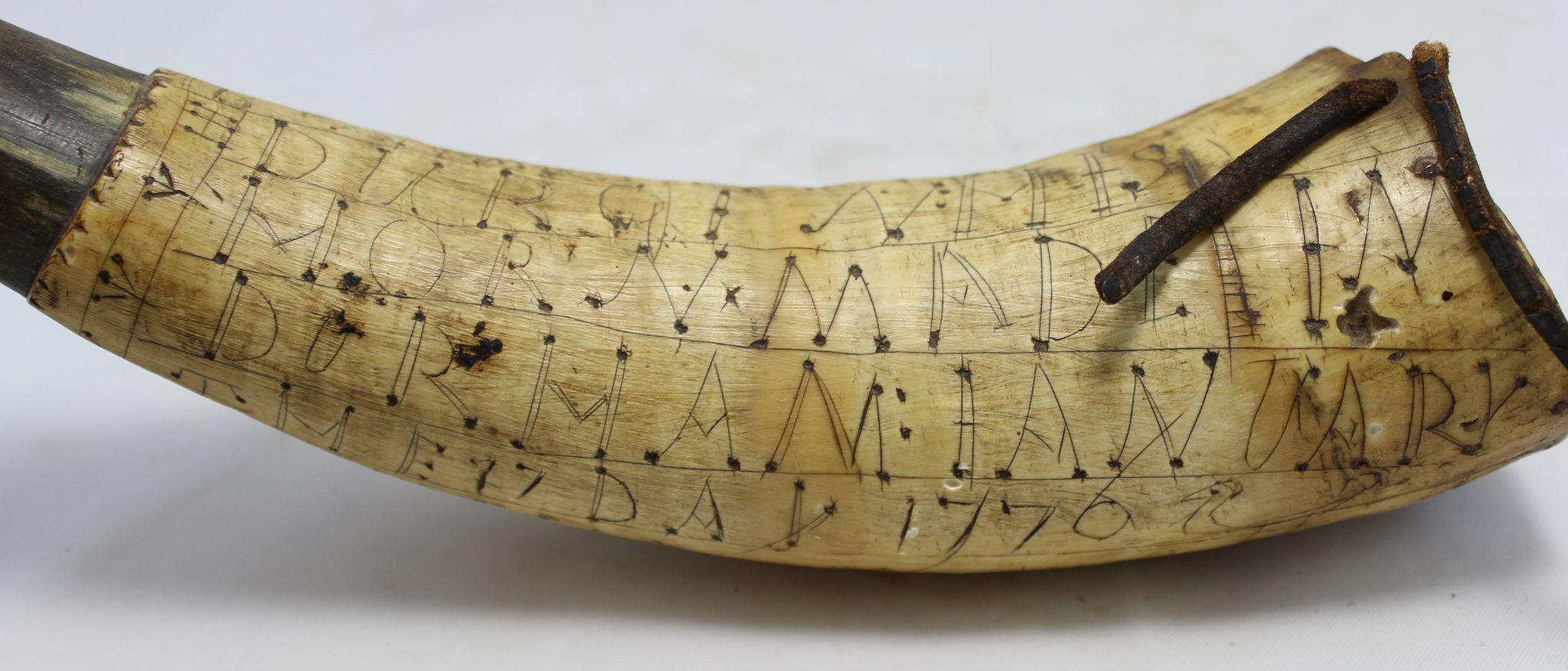 This artfully engraved powder horn belonging to the prominent Dr ...