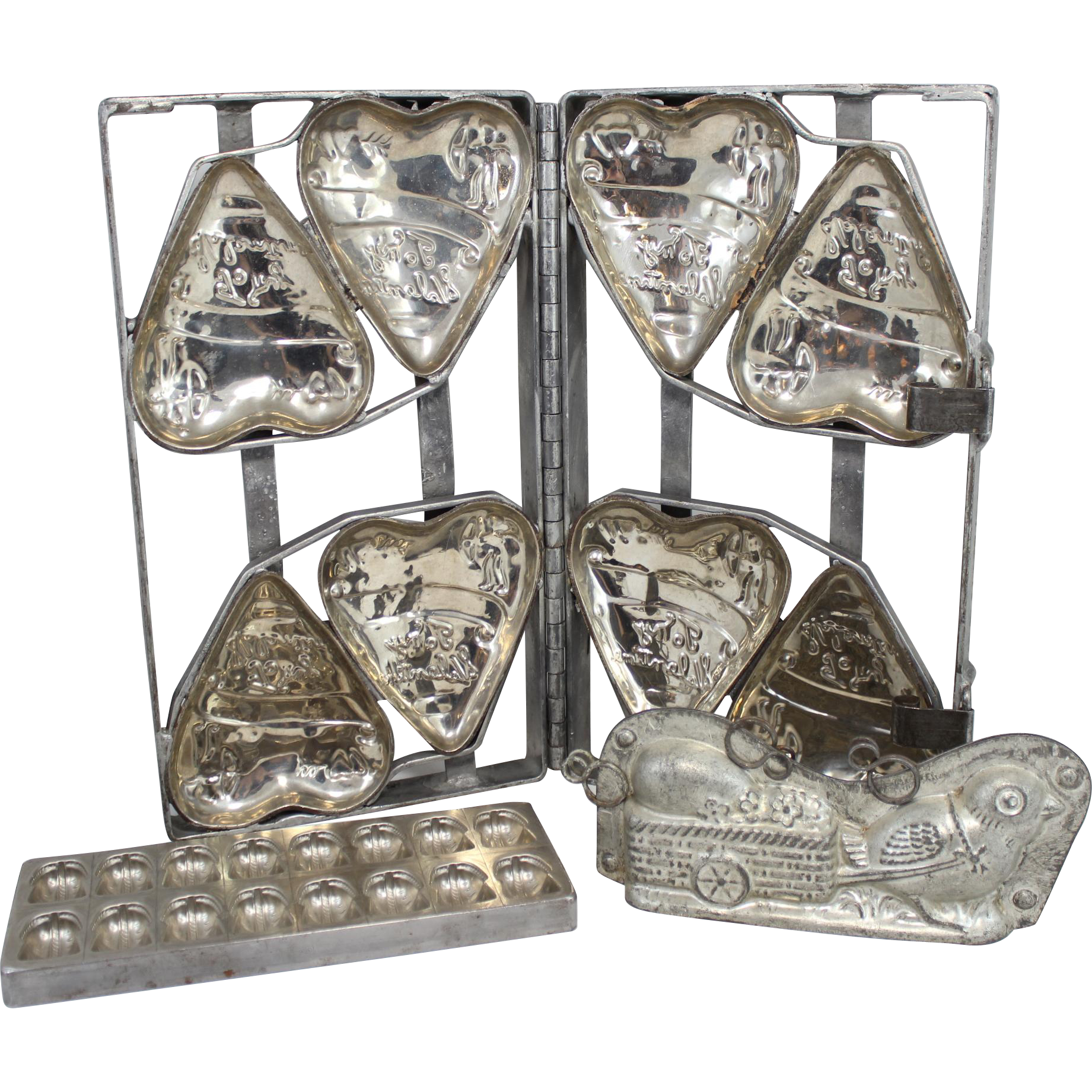 Group of Three Vintage Metal Chocolate Molds