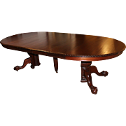 19th Century American Mahogany Split Pedestal Dining Table with Four Leaves