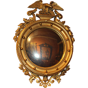 Colonial Revival Giltwood Convex Looking Glass with Carved Eagle