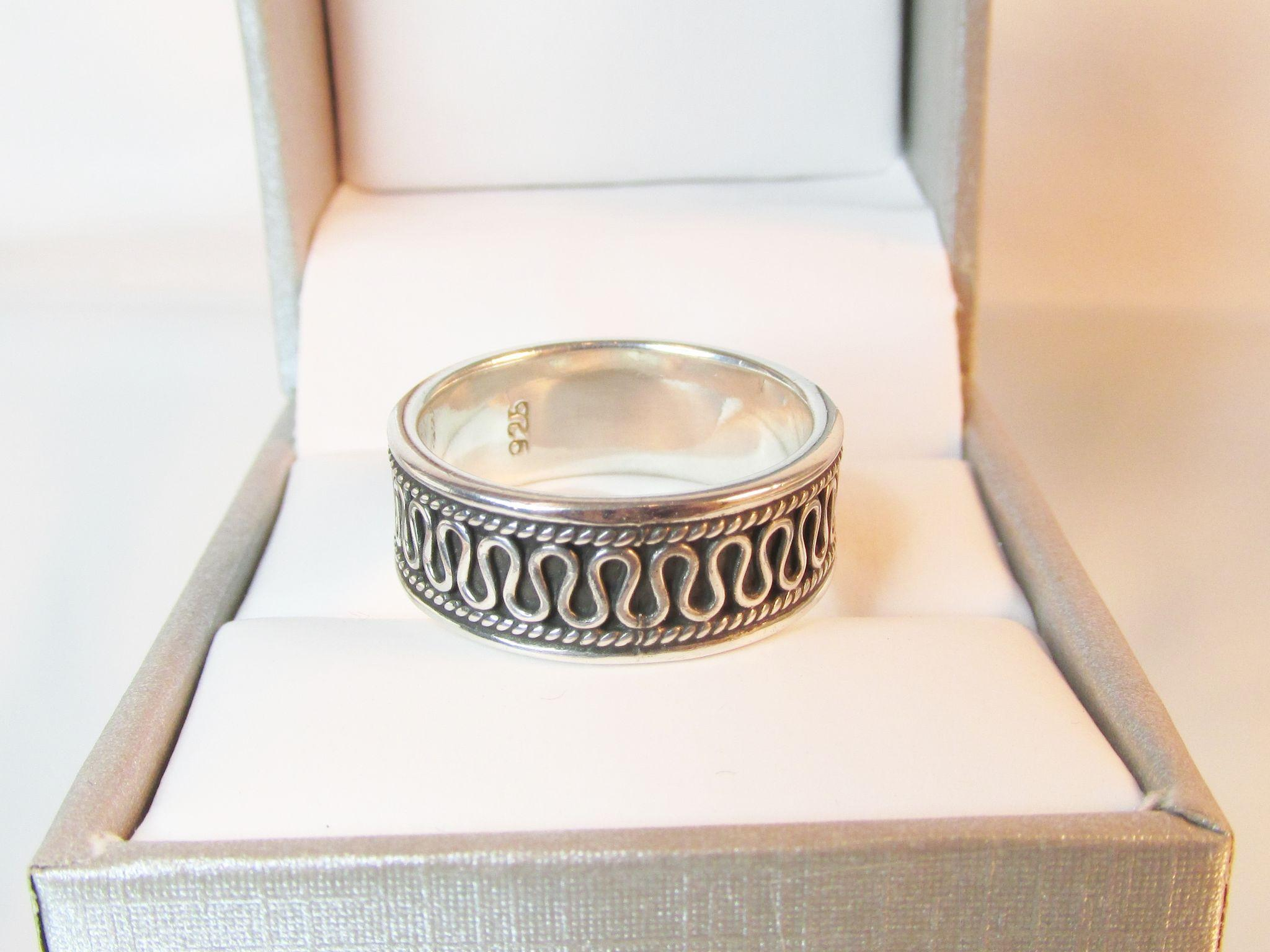 sterling band ring with swirl design vintage from ninas on