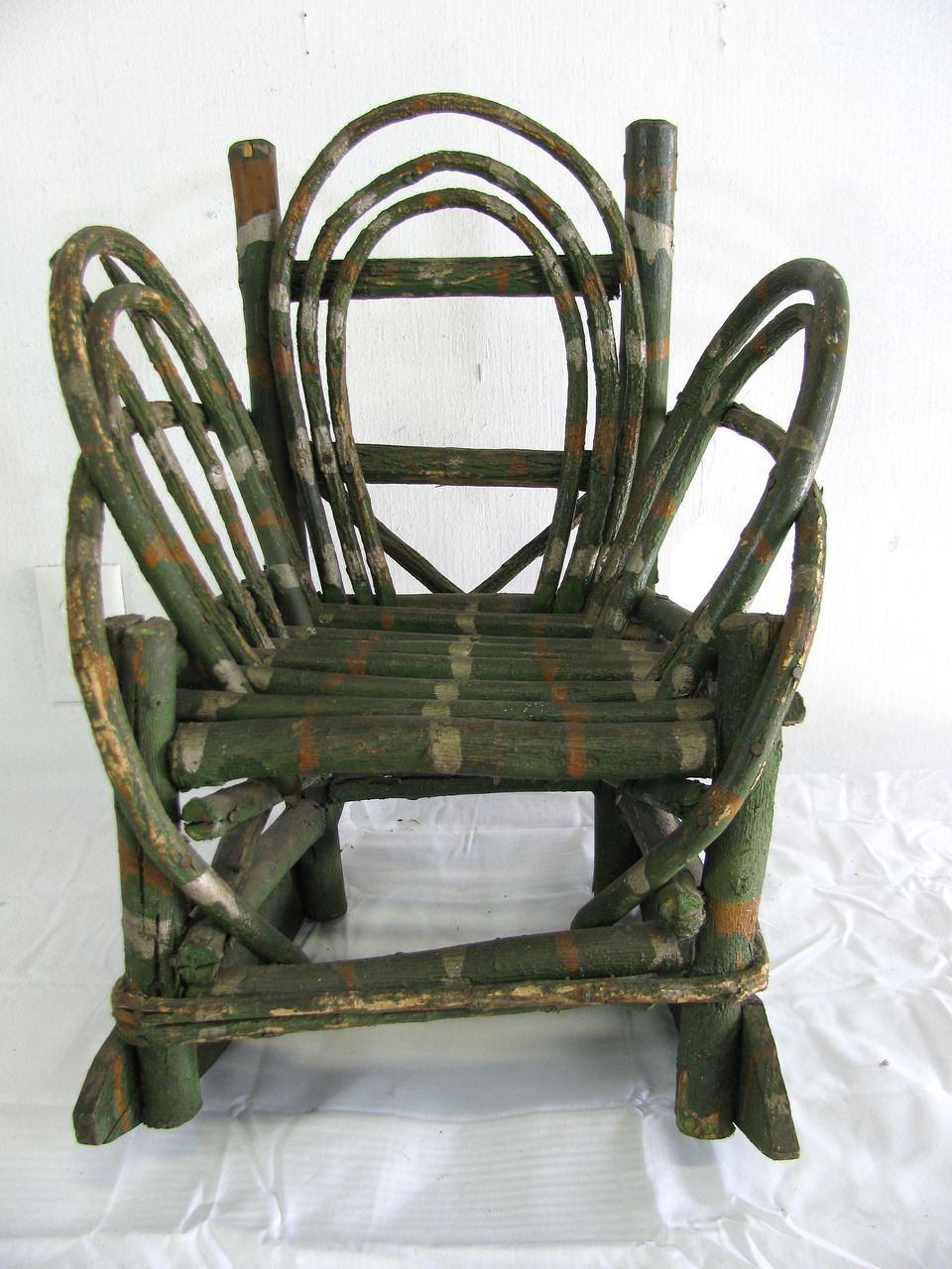 Vintage folk art painted child s twig rocking chair from