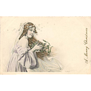SALE: Antique Artist Signed Girl with Stars Christmas Postcard c1900.