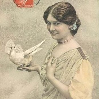 Antique French 'Girl with Dove' Hand Colored Real Photo Postcard 1912.