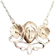 Antique Victorian Silver Pendant Necklace 'Young Lady with Poppies in her Hair'.