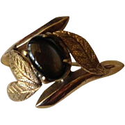 SALE: 18 Karat Yellow Gold and Black Star Sapphire Cocktail Ring c1970.