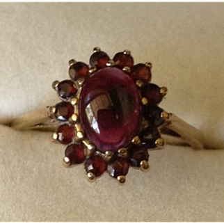 Beautiful 9Karat Gold and Garnet Basket Set Ring.