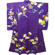 Antique Purple Silk Crepe Japanese Furisode Kimono with Embroidered Flowers, Trees, Hand painted Gold Embellishment and Family Crest. c1900