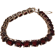 Substantial Garnet and Sterling Silver Tennis Bracelet.