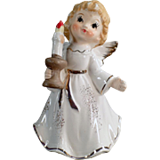 Old, Porcelain Christmas Angel Holding a Candle