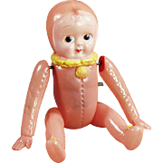 Vintage Wind-up, Celluloid Baby Doll in Pink Bunting