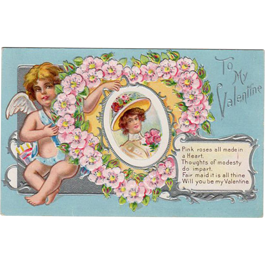 Vintage Valentine Postcard with a Cherub and Floral Heart