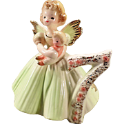 Vintage Josef Original - Birthday Angel - Age Seven with Baby Doll