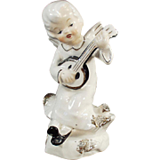 Vintage Porcelain Angel Playing an Instrument