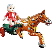 Vintage Wind Up Toy - Celluloid Boy on Tin Horse Cart
