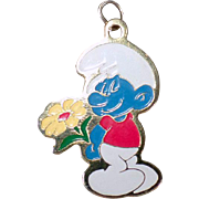 Vintage Smurf Charm or Pendant - 1980 Peyo – Smiling Blue Smurf with Yellow Flower
