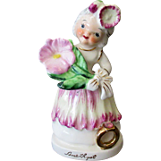 Vintage Ceramic Birthday Figure for February with Flower and Amethyst Birthstone