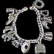 Vintage Sterling Silver Charm Bracelet - Fifteen (15) Interesting Western Motif Charms on Chain