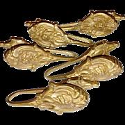 Leafy gilded brass curtain tiebacks