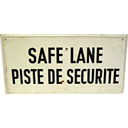 White and black 'safe lane' imported sign