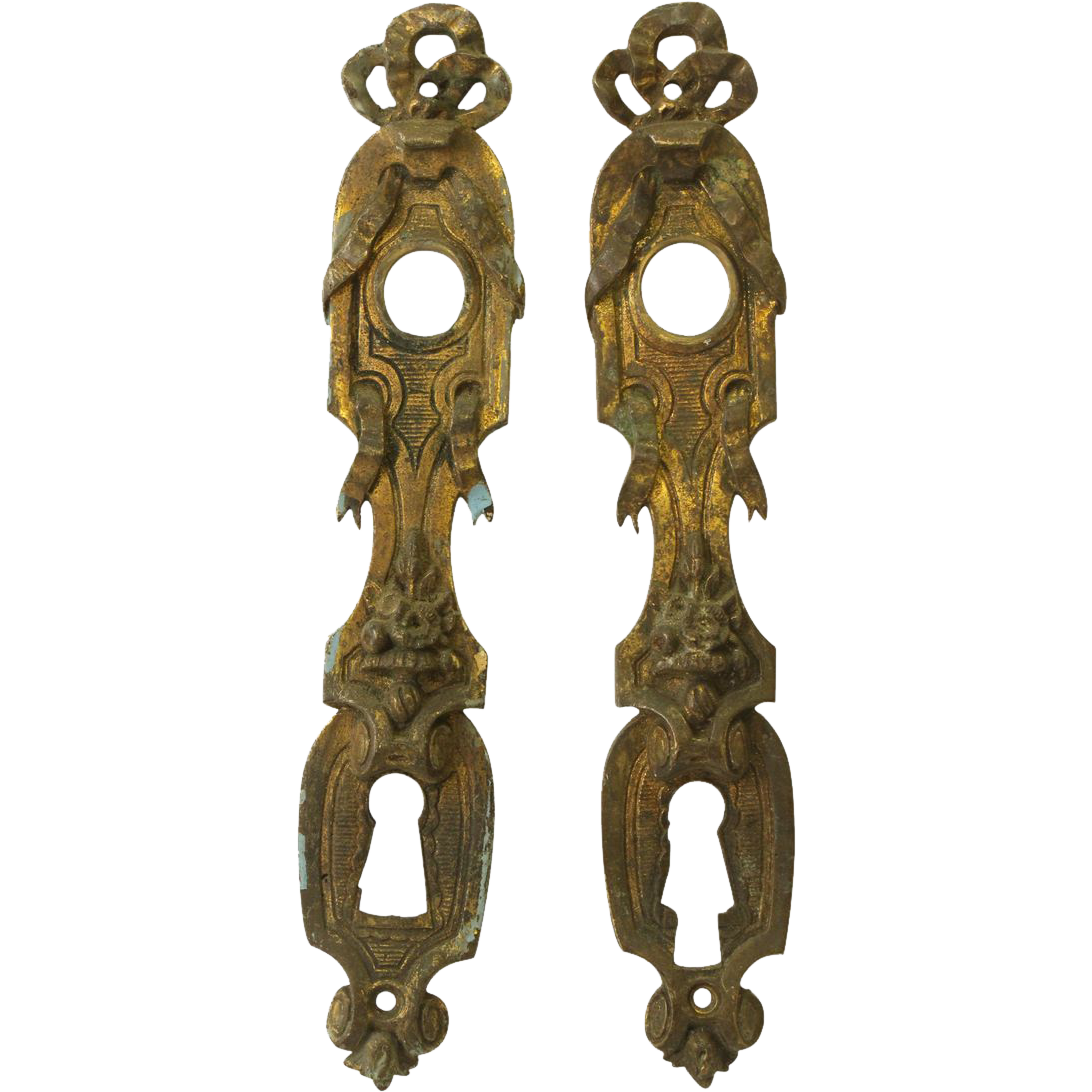 Pair of ornate European back plates