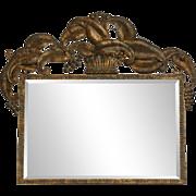 Metal framed beveled mirror with crown design