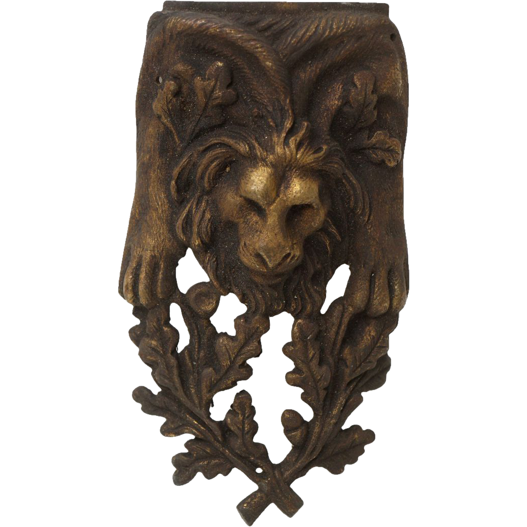 Set of French cast bronze appliques with lion heads.