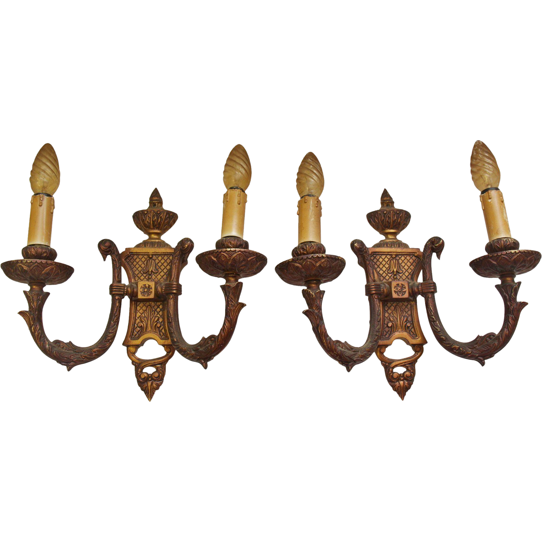 Pair of copper washed ornate two arm sconces