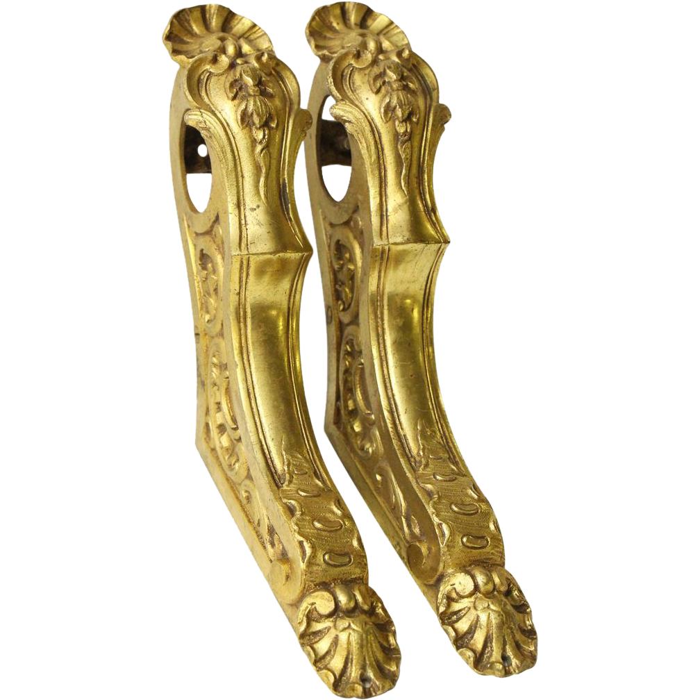 Ornate set of gold finished cast bronze bar brackets