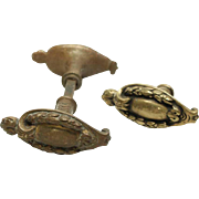 Set of ornate lever doorknobs