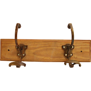 Turn of the century brass hooks on wood plank