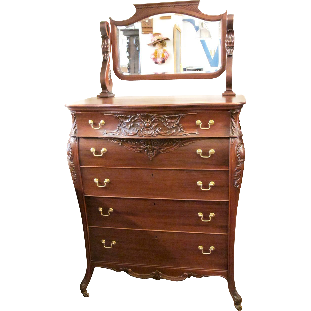 Tall mahogany dresser with beveled mirror and swan detail