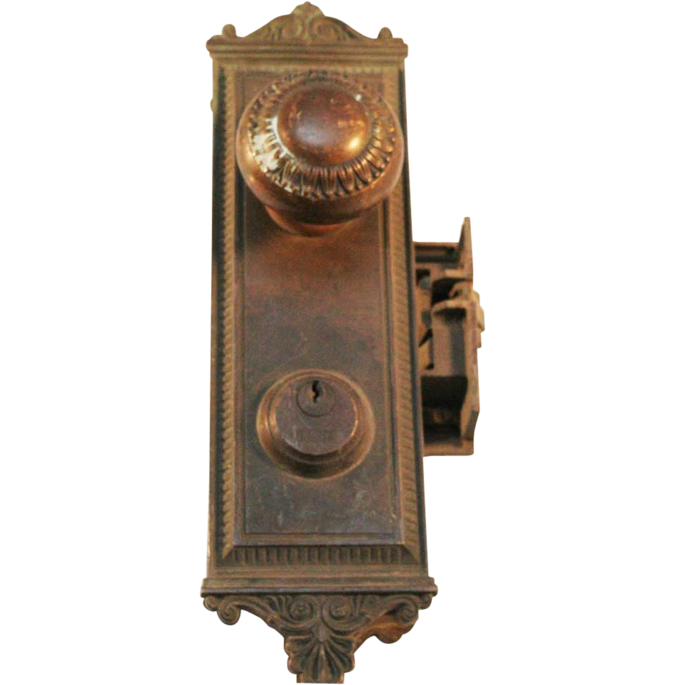 Brass doorknob set with lock and backplate