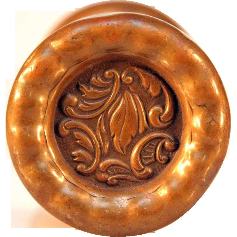 Vintage round decorative brass doorknob with ornate detail