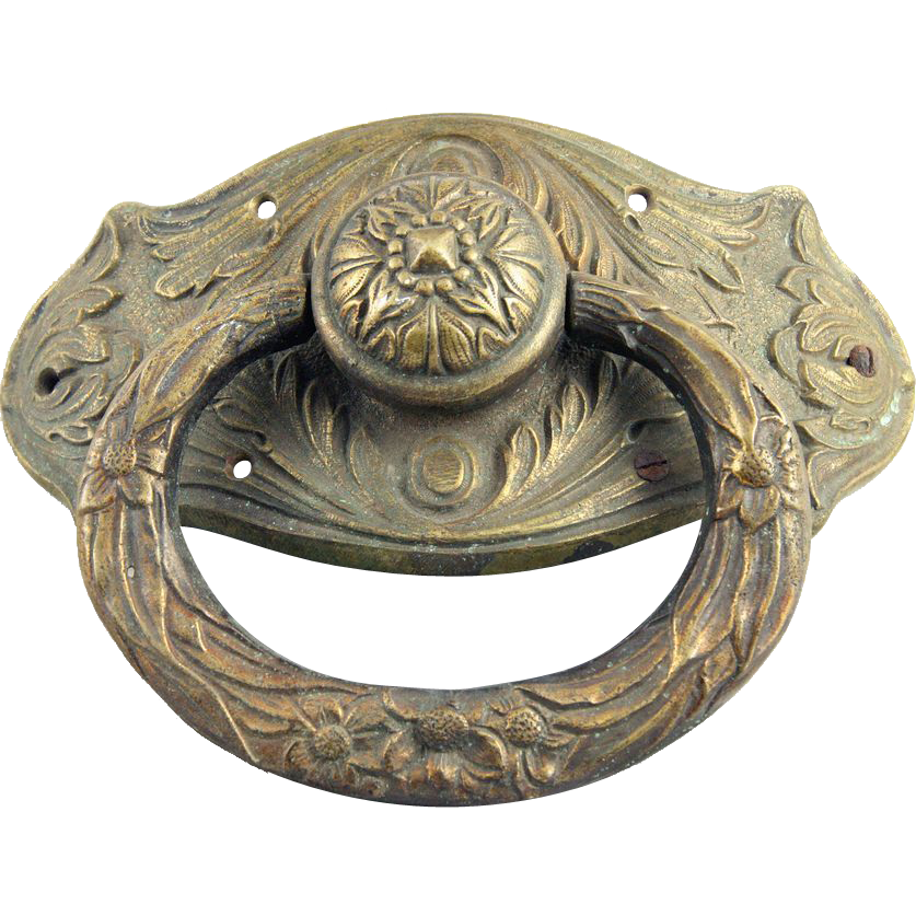 Cast brass decorative door knocker with antique patina