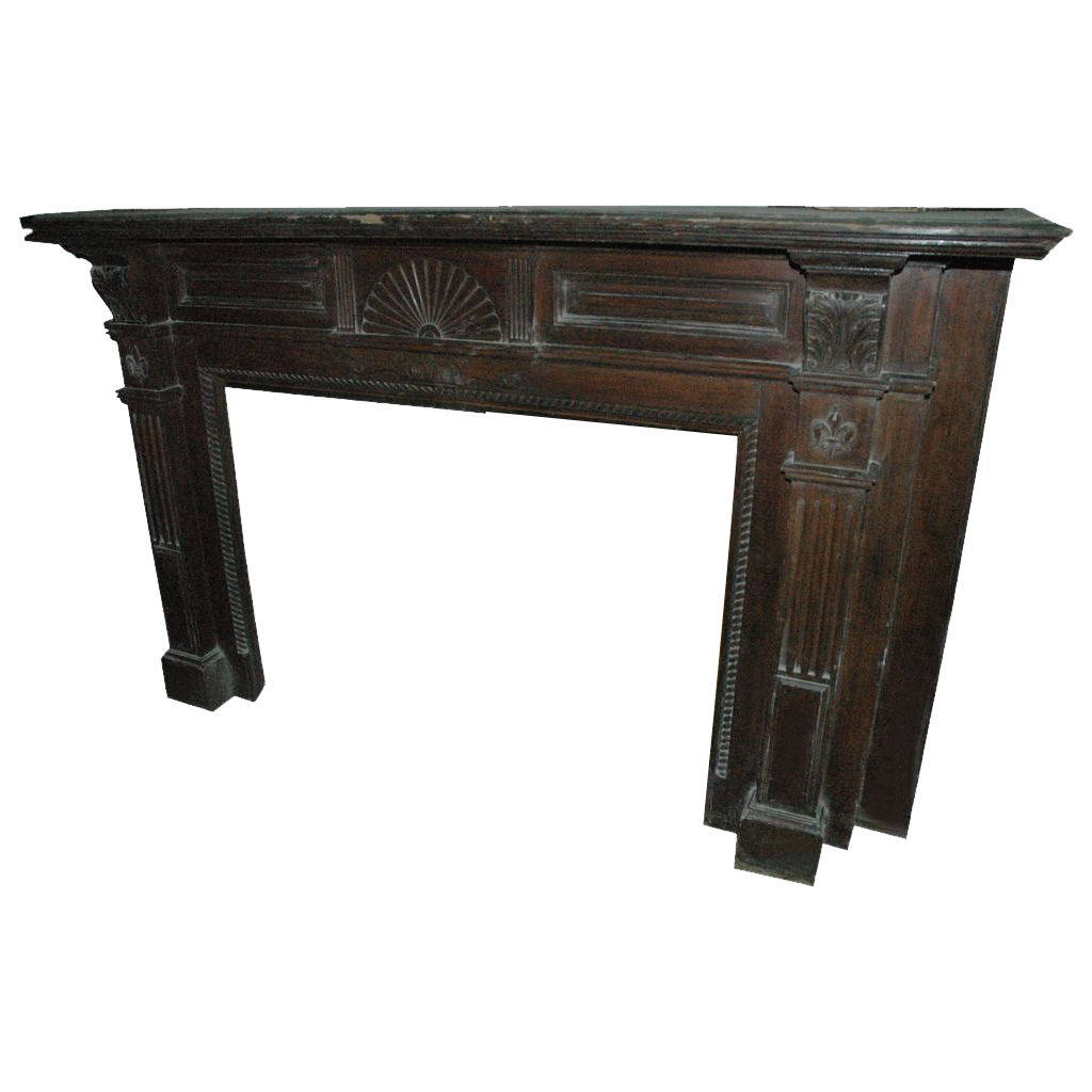 Mahogany mantel with fleur de lis carvings