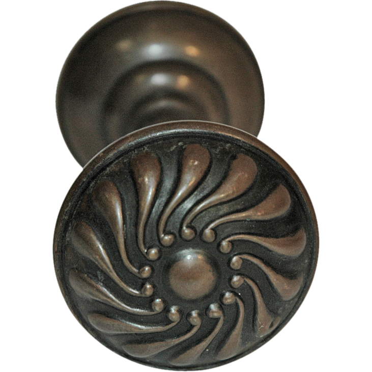 Turn of the century brass swirl knobs