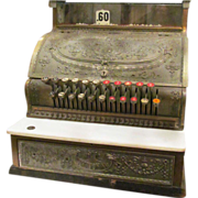 Mid sized National cash register with carved Victorian details