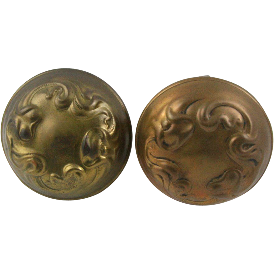 Pressed brass interior doorknob pair