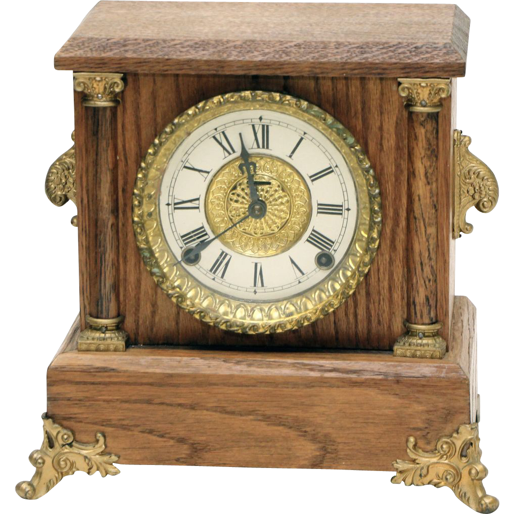 Vintage wooden Roman numeral clock with ornate hardware