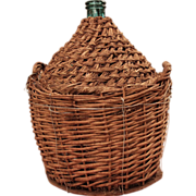 Wine jug inside woven reed skirt damigiana